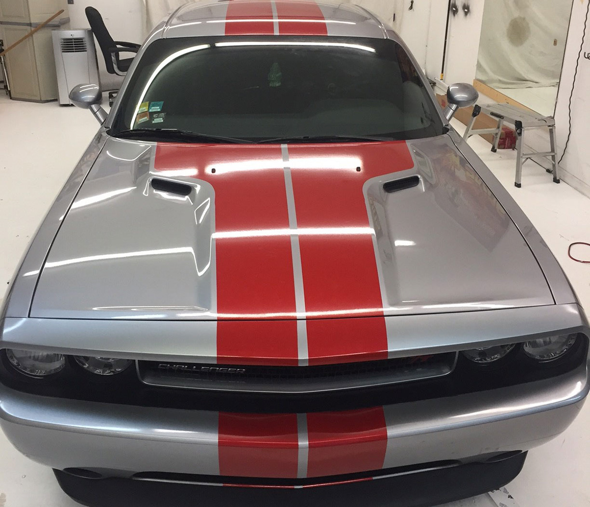 Custom Red Rally Racing Stripes On This Silver Dodge Challenger